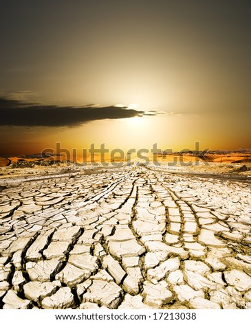 sunset on the ground dried by dryness - stock photo