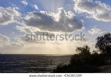 Sunset on the horizon over see and the Blue Grotto area at Malta - stock photo