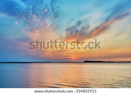 Sunset on the lake - stock photo