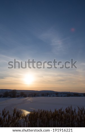 sunset on the lake in winter