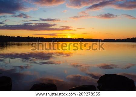 Sunset on the lake Vuoksa - stock photo