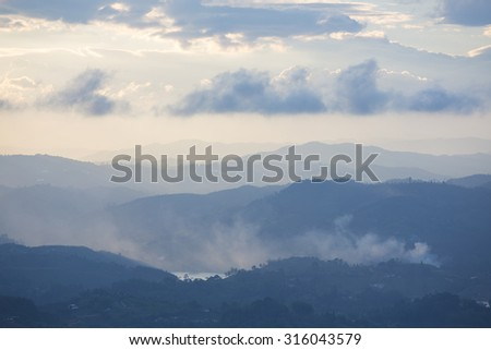 Sunset on the mountains and islands in Guatape taken from Piedra el Penol with cloudy sky, near Medellin, Colombia. - stock photo