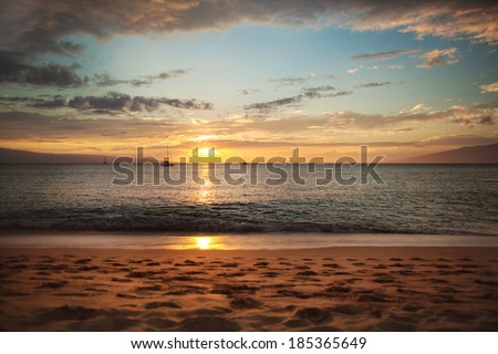 Sunset on the ocean beach - stock photo