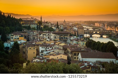 Sunset on the ponte vecchio in Florence - stock photo