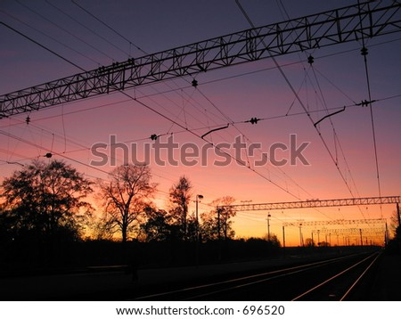 Sunset on the railroad - stock photo