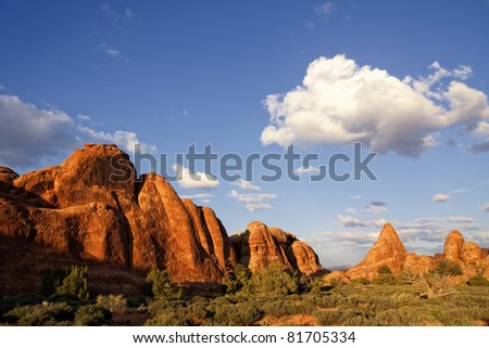 Sunset on the red rocks of Arches National Park in Utah - stock photo