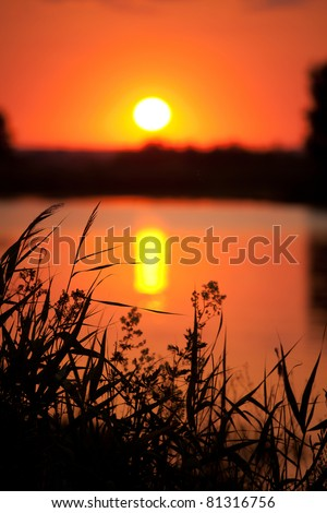 sunset on the river - stock photo