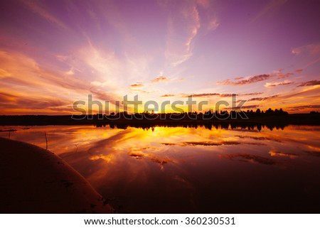 Sunset on the river  beach with beautiful sky - stock photo