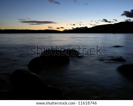 Sunset on the rocks - stock photo