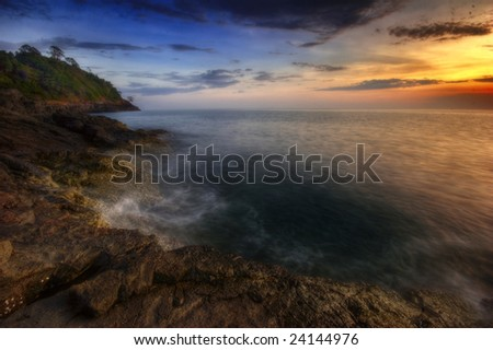 Sunset on the rocks. Siam bay. Province Trat. Koh Chang island. Kingdom Thailand