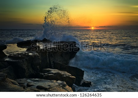 sunset on the rocky beach