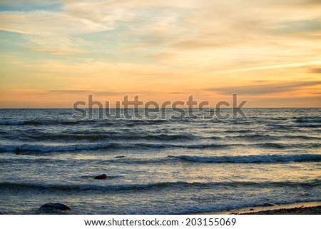 Sunset on the sea coast. Sunset sky - stock photo