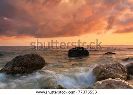 Sunset on the sea shore - stock photo