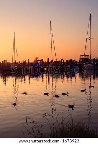 Sunset on the shore of Lake Michigan at Leland, Michigan - stock photo