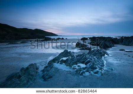 Sunset on the shores of Rockham Beach, Morte Point, Devon. - stock photo