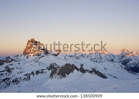 sunset on the South slope of the peak Midi d'Ossau, 2884 meters, Ossau Valley, Pyrenees, France - stock photo