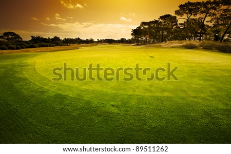 Sunset on the 18th - stock photo