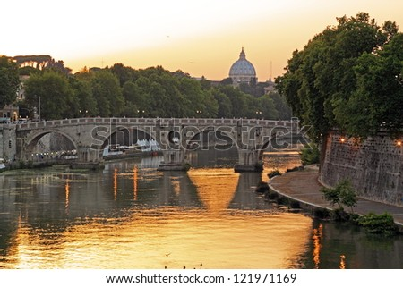 Sunset on the Tiber, the river of Rome, and it's bridges with Saint Peter in the background