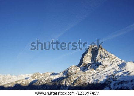 sunset on the western slope of the peak Midi d'Ossau, 2884 meters, Ossau Valley, Pyrenees, France - stock photo