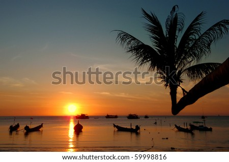Sunset on tropical beach. Kai Bay Beach. Ko Chang island, Thailand - stock photo