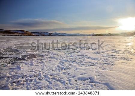 sunset on winter Baikal lake - stock photo