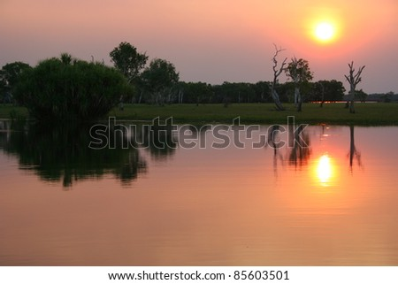 Sunset on Yellow river in Kakadu national park in the Northern Territory of Australia - stock photo
