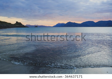 Sunset or dusk on a beautiful norwegian white sand beach, Lofoten Islands