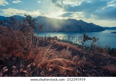 Sunset over a barren hill in a tropical climate