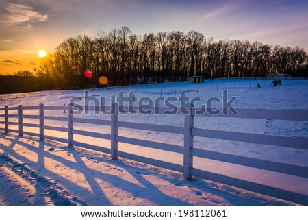 Sunset over a farm field in rural Carroll County, Maryland. - stock photo