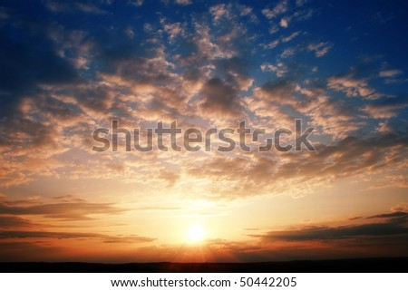 Sunset over a field. - stock photo