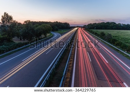 sunset over a german highway - stock photo