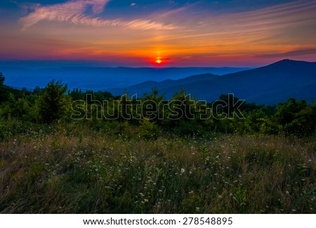 Sunset over a meadow at Pass Mountain Overlook, Skyline Drive, Shenandoah National Park, Virginia. - stock photo