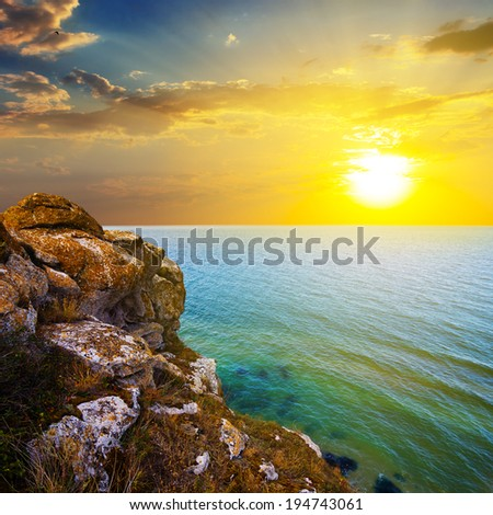 sunset over a sea bay