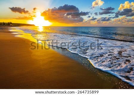 sunset over a sea beach - stock photo