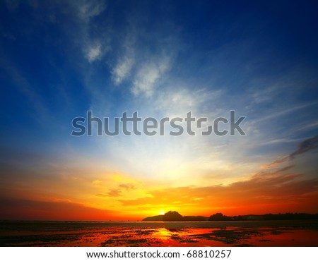 Sunset over a sea during tide. Andaman sea - stock photo