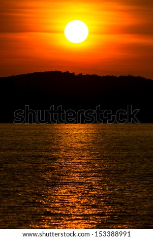 Sunset over a tropical island in the South China sea - stock photo
