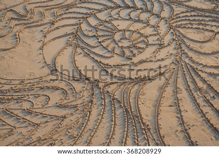 sunset over abstract draw in the sand - stock photo