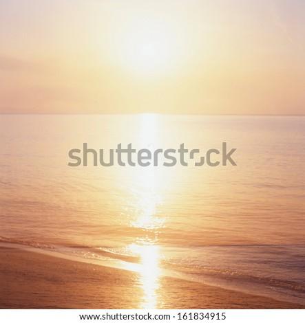 Sunset over an ocean - stock photo