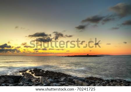 Sunset over Atlantic ocean - Crab Island in Ireland - stock photo