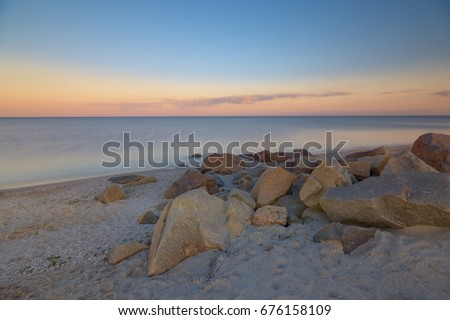 sunset over azov sea rocks long exposure