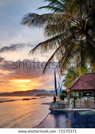 Sunset over Balinese coastline - stock photo