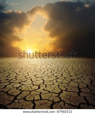 sunset over barren land - stock photo