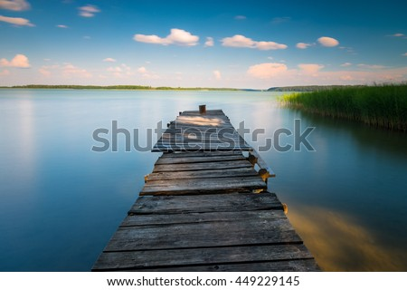 Sunset over beautiful lake in Mazury lake district. Afternoon in Poland. Lake alndscape at sunset - stock photo