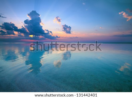 Sunset over beautiful seaside - stock photo
