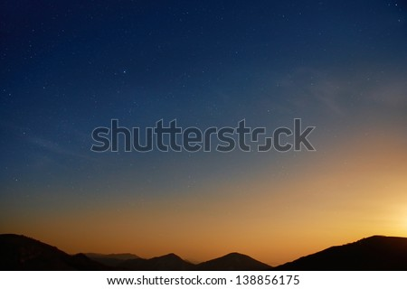 Sunset over blue dark night sky with many stars. Space background - stock photo