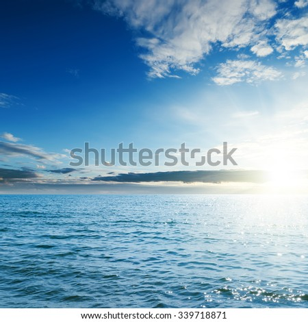 sunset over blue sea