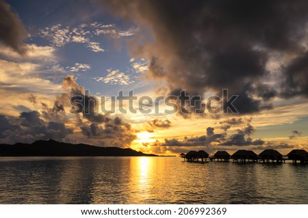 Sunset over Bora Bora Island - stock photo