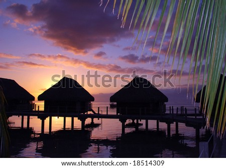 Sunset over bungalows - stock photo
