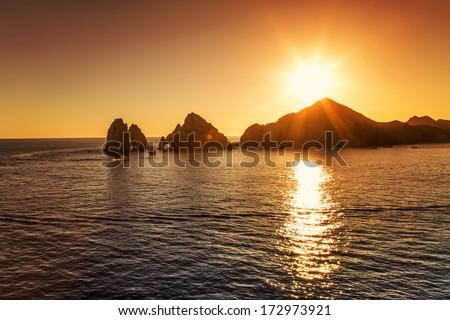 Sunset over Cabo San Lucas - stock photo