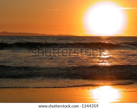 Sunset over Catalina Island from Newport Beach. - stock photo